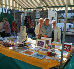 Muriel, Gill and Val behind our stall at the market