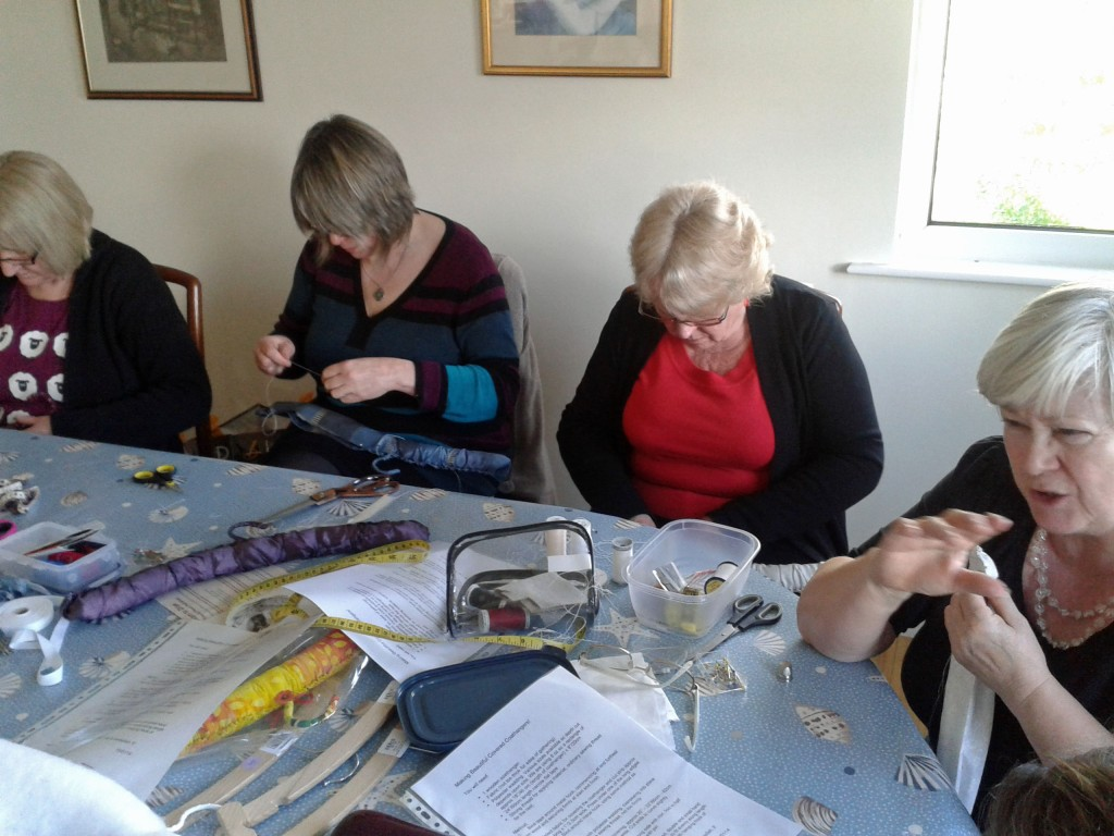 Sue Badcock, Mary Venn, Val Puddiphatt and Kathy Merrett all concentrating hard on their coat hangers.
