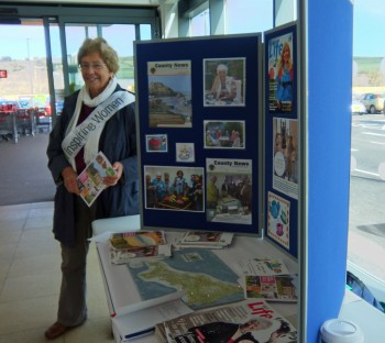 Avril Woolcock (WI Advisor and member of Gwinnear WI) with the CFWI table at Sainsbury's.