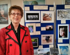 Wend Allen stands proudly in front of the CFWI photo competition entries
