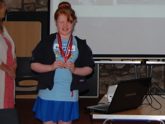 Joanna Nankervis shows off her Transplant Games medal  as she talks to us about her experience  as a kidney transplant recipient.