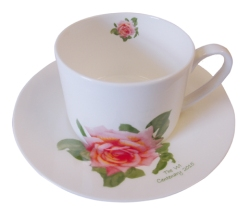 A bone china cup and saucer featuring a design based on the Inspiration Rose and hand-decorated in Stoke-on-Trent