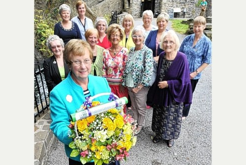 Glamorgan County Chairman Carolyn Davies  holds the commemorative Baton with members of  Neath WI at Aberdulais Falls.