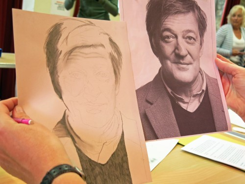 Alison works on a drawing of Stephen Fry.