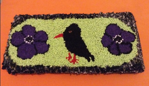 Clever Sue designed this beautiful cushion featuring anemones and a chough.