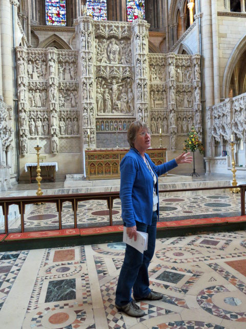 Pam showing us the reredos