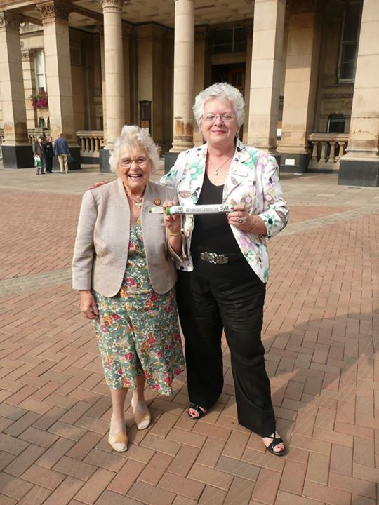Here Warwickshire Federation Chairman Jeryl Stone is passed the baton from the West Midlands Federation.