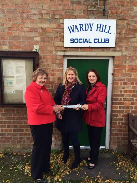 The baton drops in to visit the members of Wardy Hill WI.