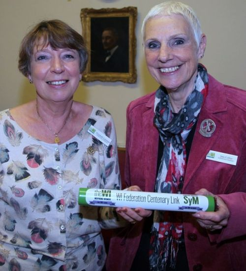 Elizabeth Lansman, Chairman of Suffolk West Federation, passes on the baton to Jane Collier, Chairman of Suffolk East.