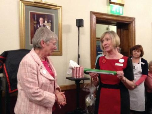 Norfolk Federation Chairman Wendy Adams receives the baton from Cambridge Federation Chairman Sally Kingsman