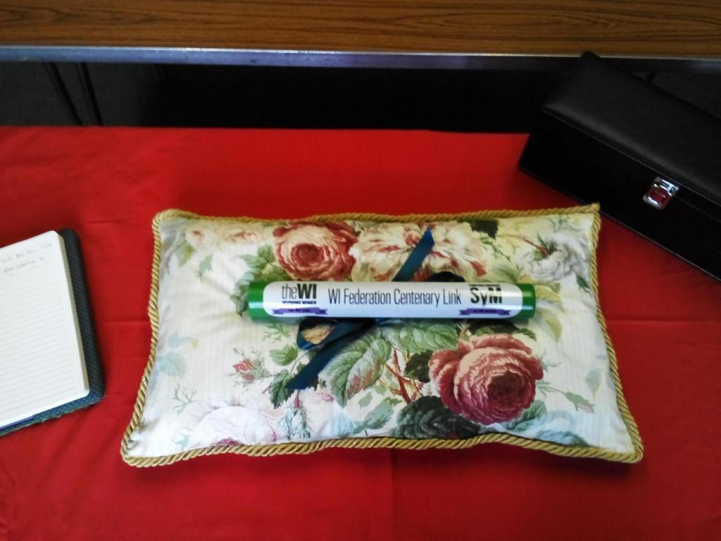 The Norfolk cushion proudly displays the baton
