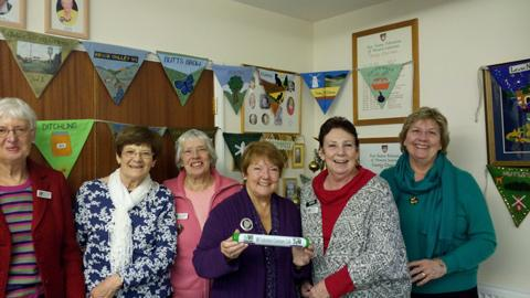 Members of the East Sussex Federation pose with the baton,