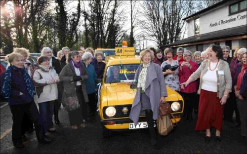 Alresford WI chairman Gill Graham holds the baton