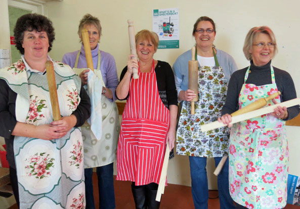 Sue, Liz, Margie, Alison and Lis wield their rolling pins