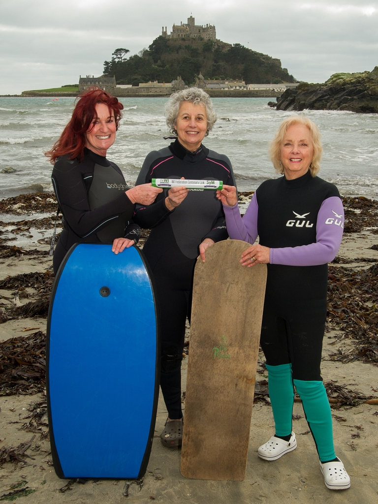 WI members Niamh Noone, Jane Twose and Pat Gloyn pose with surfboards in Marazion (057) Photo by Peter Puddiphatt