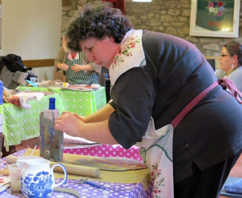 Sue working on her vase