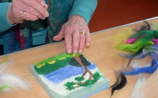Val puts some final touches on her lovely piece of needle felting